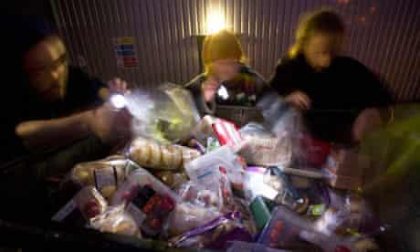 Freegans take food from a bin