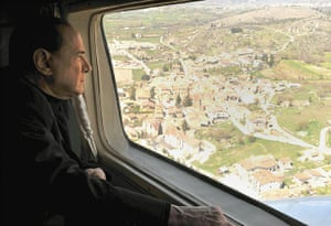 berlusconi: Prime Minister Silvio Berlusconi flies over the area of L'Aquila