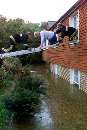 Floods 2000: FIREMEN RESCUE AN ELDERLY WOMAN FROM HER HOME IN LEWES