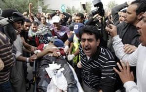 bahrain: A Bahraini anti-government demonstrator lies injured