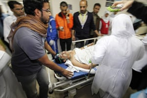 bahrain: An injured protester is rushed to the operating theatre in a hospital
