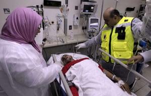 bahrain: A wounded Shiite Bahraini demonstrators