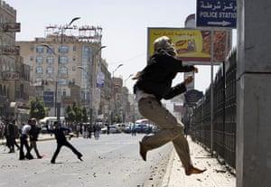 Yemen: A Yemeni anti-government protester jumps