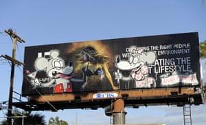Banksy in LA: A billboard poster tagged by graffiti artist Banksy on Sunset Boulevard