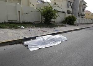 bahrain: corpse on the street in manama