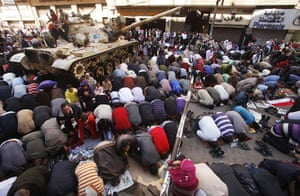 Egypt Demonstrations: Egyptian pro-democracy supporters pray in Tahrir square, Cairo, Egypt