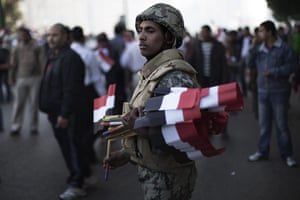 Egypt Demonstrations: An Egyptian soldier greets demonstrators in Tahrir square, Cairo, Egypt