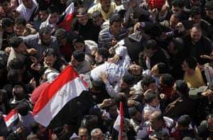egypt: A man who fainted in the crowd is carried away in Tahrir square