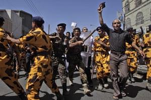 Yemen Protests: Yemeni riot police charge towards anti-government demonstrators