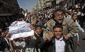 Yemen Protests: Yemeni anti-government demonstrators react during a demonstration