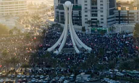 Anti government protestors march into Pearl roundabout after the military and police left in Manama