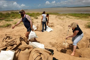 Cyclone Yasi preparations: Local residents of Townsville fill sandbags at the beach