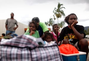 Cyclone Yasi preparations: Family wait outside an emergency cyclone shelter in Cairns