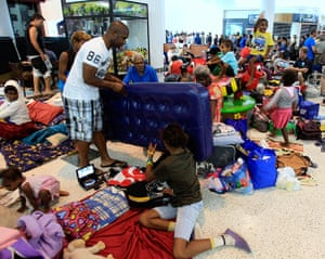 Cyclone Yasi preparations: People pack a shopping mall used as an evacuation shelter in Cairns