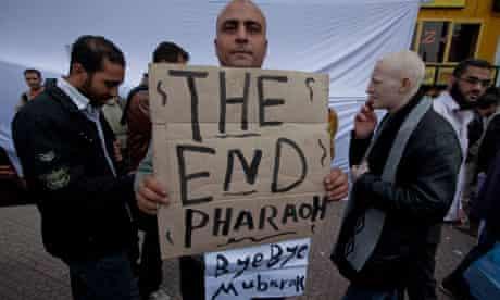 Protestor holding sign against Hosni Mubarak in Tahrir Square, Cairo
