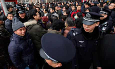 Police on the streets of Shanghai after an online call for demonstration sparked a crackdown
