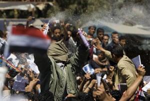 Arab protests: Sana'a, Yemen: Anti-government protesters spray foam