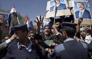 Arab protests: Sana'a, Yemen: Yemeni policemen push back government supporters