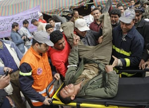 Arab protests: Baghdad, Iraq: An anti-Iraqi government protester is taken to hospital