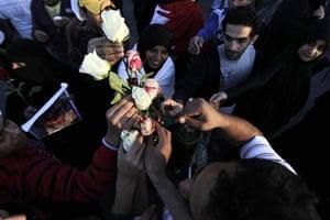 Arab protests: Manama, Bahrain: Bahraini anti-government protesters distribute roses