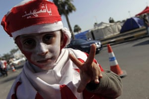 Arab protests: Manama, Bahrain: A young anti-government protester wearing a headband