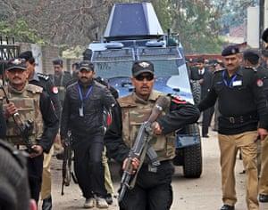 Pakistan: Pakistani police escort an armoured vehi