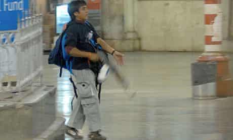 Ajmal Kasab walks through the Chatrapathi Sivaji Terminal train station in Mumbai