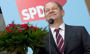 Olaf Scholz of the SPD celebrates his party winning an absolute majority in the Hamburg parliament