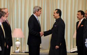 raymond davis: US senator John Kerry visits Pakistan