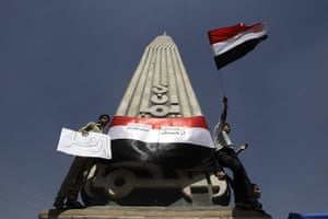middle east unrest: An anti-government protesters wave Yemen's national flag