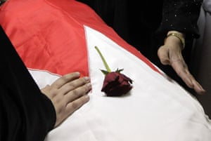 middle east unrest: Bahrainis mourn over the body of Redha Mohammed