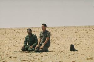 Muammar Gaddafi : August 1973: praying in the desert near Surt