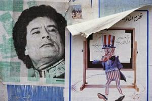 Muammar Gaddafi : Posters of Libyan leader Muammar Gaddafi and Uncle Sam in 1986