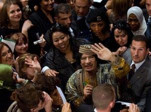 Muammar Gaddafi : June 2009: Libyan leader Muammar Gaddafi waves to photographers