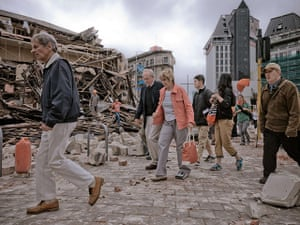 new zealand earthquake: People walk through debris in Christchurch