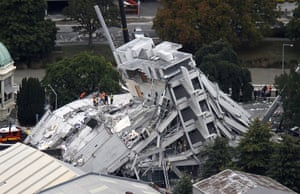 New Zealand earthquake: Rescue workers climb onto a building in Christchurch, New Zealand