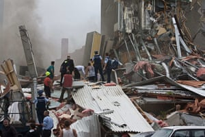 New Zealand earthquake: Rescue workers search for survivors in a collapsed building Madras Street