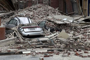 New Zealand earthquake: Cars are crushed by fallen concrete after an earthquake in Christchurch