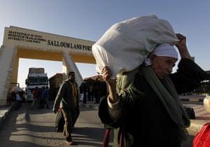 Libya unrest: Egyptians who fled from Libya through the Salloum land port gate