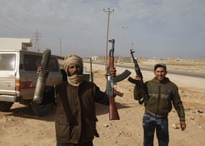 Libya unrest: Protesters show a mortar shell used to destroy a munitions store