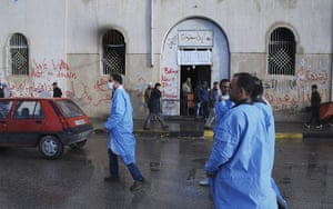 Libya unrest: Libyan medical volunteers walk past Benghazi court