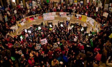 Protestors fill the rotunda outside of Wisconsin Governor Scott Walker's office