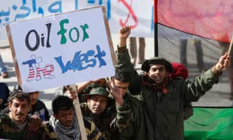 Libyan army soldiers shout slogans against Muammar Gaddafi during a demonstration, in Tobruk, Libya