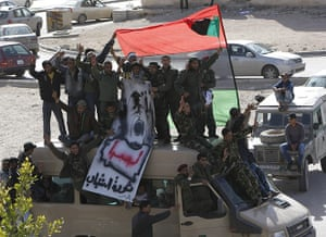 Libya unrest: Libyan army soldiers and other protesters stand on an army van