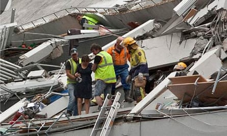Rescue workers pull people out of a building damaged by Tuesday's earthquake in Christchurch