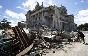 Christchurch earthquake: A rescue worker looks at the rubble of the Cathedral of Blessed Sacrament