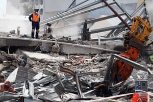 Christchurch earthquake: Rescue workers work on the remains of the CTV building