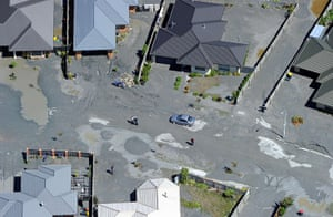 Christchurch earthquake: A suburban street is covered with silt forced out by liquefaction
