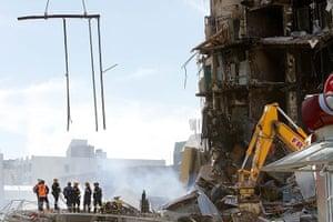 Christchurch earthquake: Rescuers stand at the smoking ruins of the CTV building