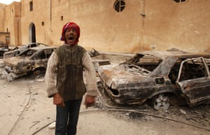 libya:  burnt vehicles in a state security building in Tobruk